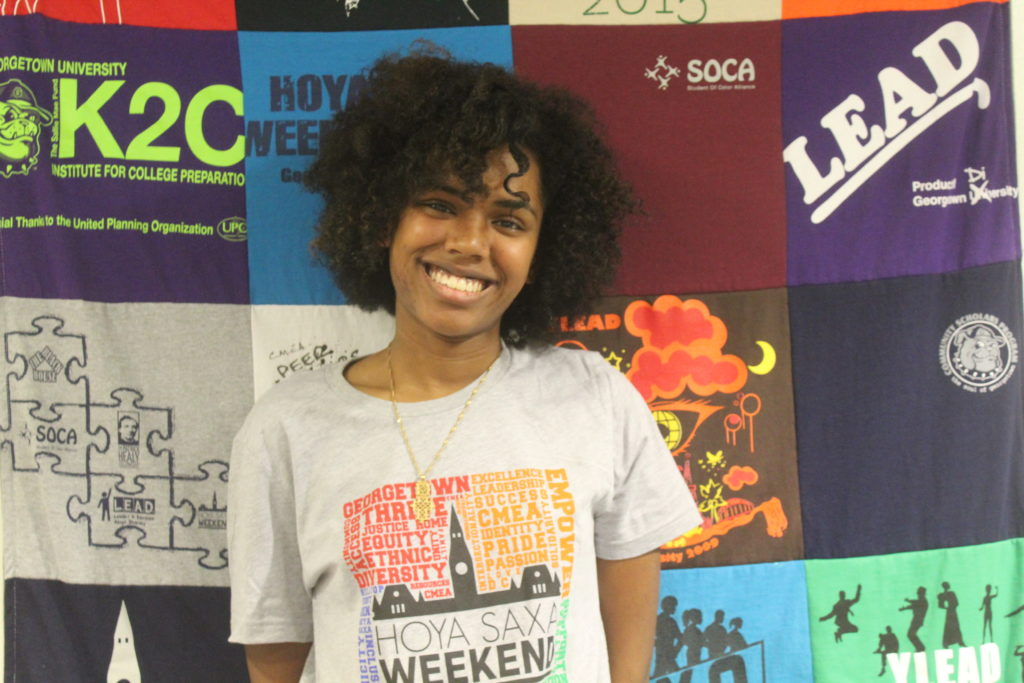 Allemai wearing a grey HSW T-Shirt in the CMEA office