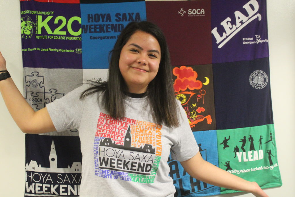 Anahi wearing a grey HSW T-Shirt in the CMEA office