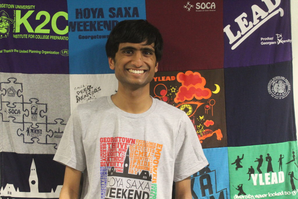 Anshul wearing a grey HSW T-Shirt in the CMEA office