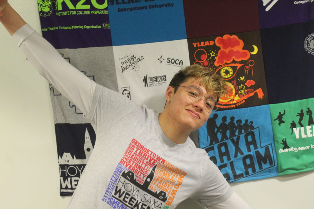Hock wearing a grey HSW T-Shirt in the CMEA office