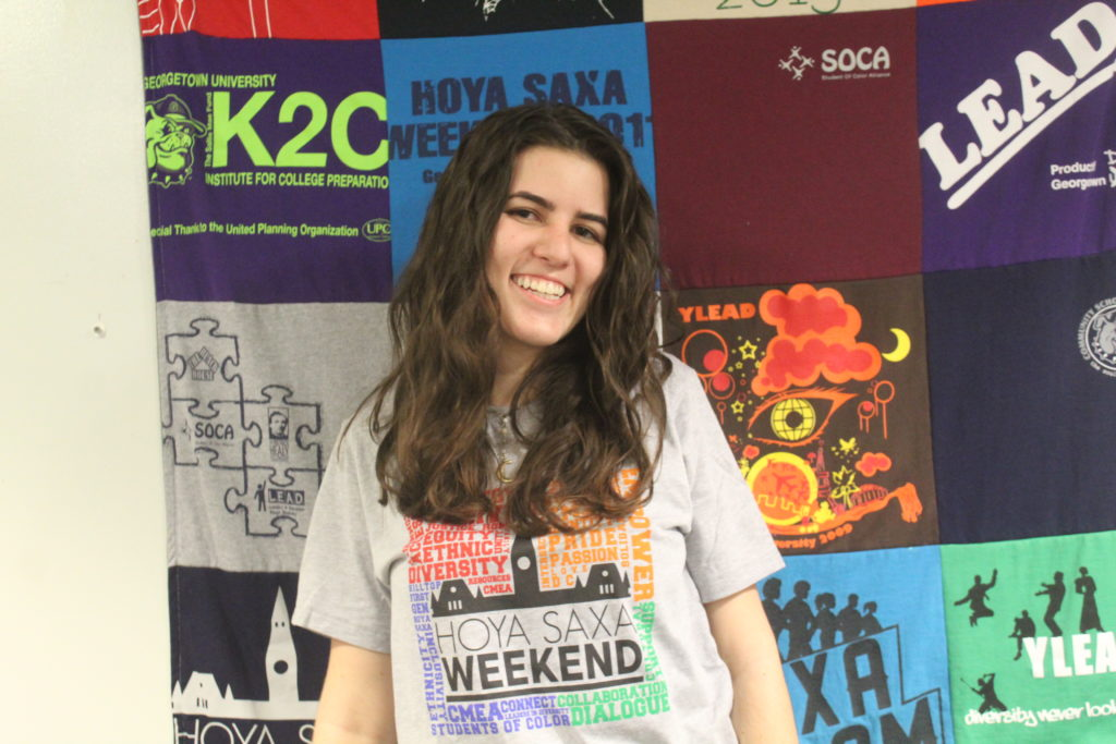 Natalie wearing a grey HSW T-Shirt in the CMEA office