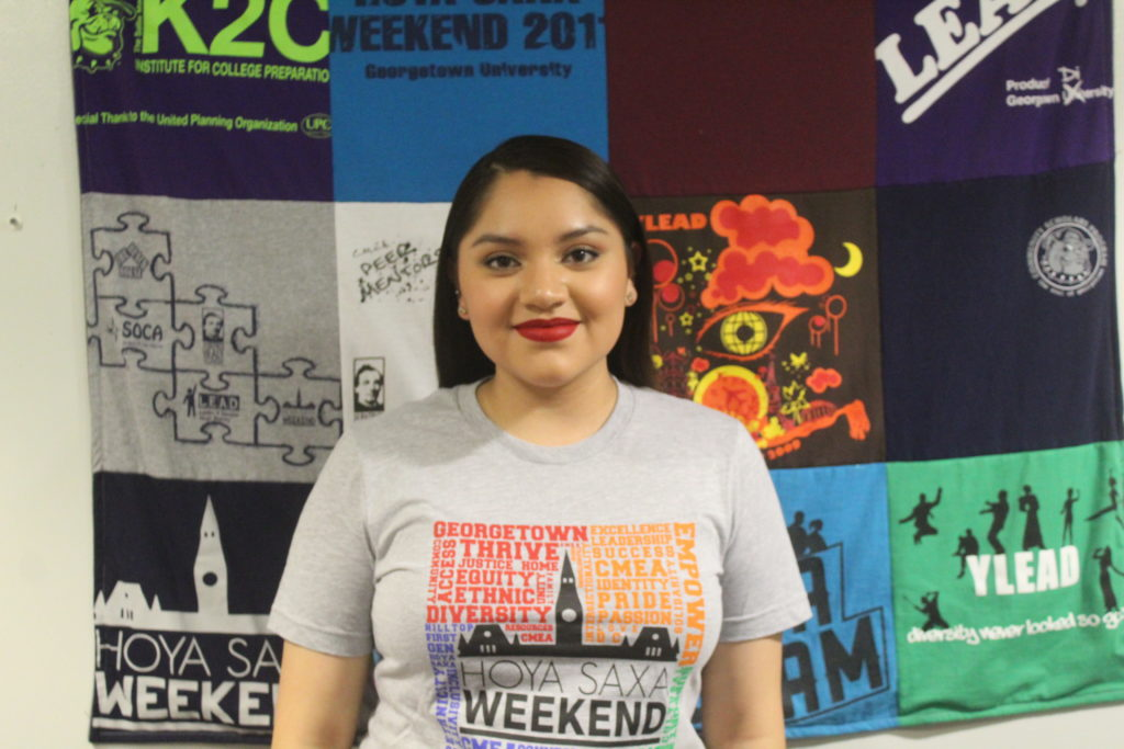 Sanjuana wearing a grey HSW T-Shirt in the CMEA office