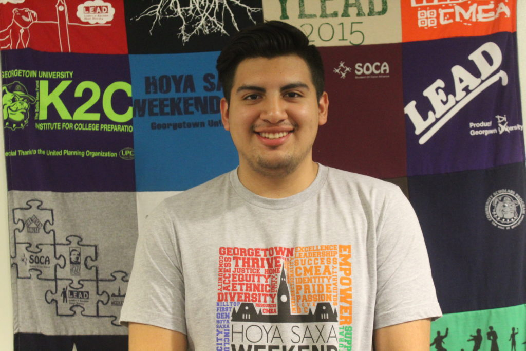Sergio wearing a grey HSW T-Shirt in the CMEA office