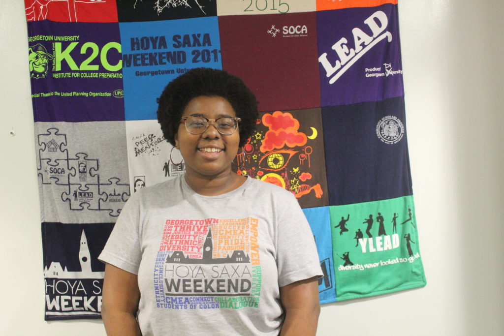 Sherley wearing a grey HSW T-Shirt in the CMEA office