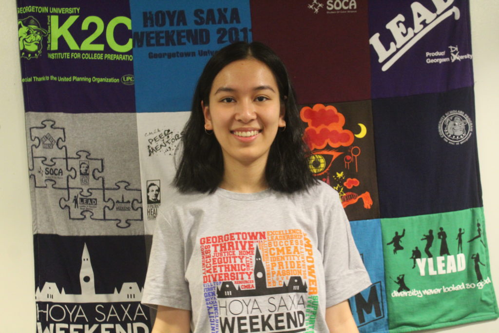 Suong wearing a grey HSW T-Shirt in the CMEA office
